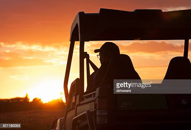man driving john deere 4x4 gator xuv - john deere stock pictures, royalty-free photos & images