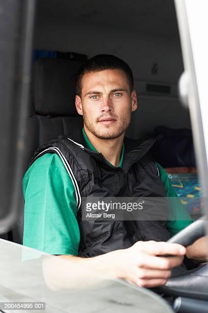 Man driving lorry, portrait, view through window