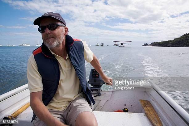 Man Driving Motorboat on Cleveland Bay