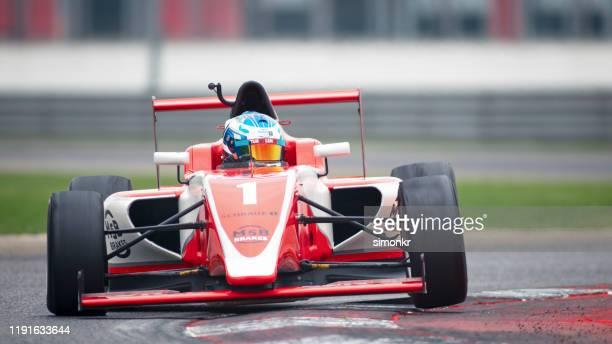 man driving racing car - racing driver stock pictures, royalty-free photos & images