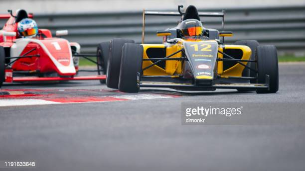 man driving racing car - motorsport stock pictures, royalty-free photos & images