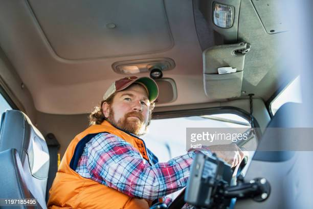 man driving semi-truck - trucker's hat stock pictures, royalty-free photos & images