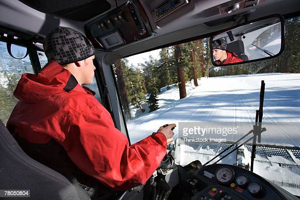 man driving snow plow - snowplow stock pictures, royalty-free photos & images
