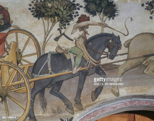 Man driving the chariot towards the fountain detail from the Fountain of Youth fresco in the Baronial Hall Castle of Manta Saluzzo Piedmont Italy...