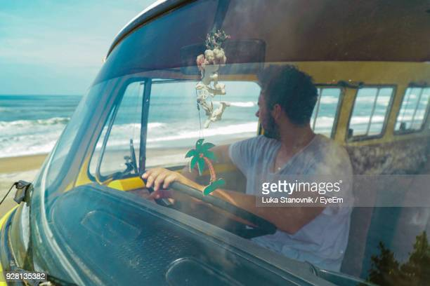 Man Driving Van At Beach