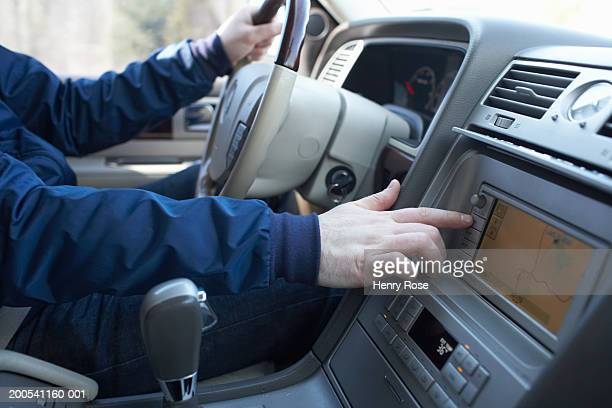 Man driving van, checking route on navigation system, close-up
