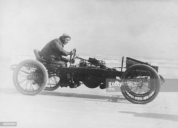 Man driving vintage race car (B&W)