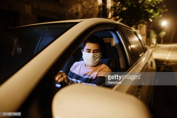 man driving with face mask - driving mask stock pictures, royalty-free photos & images