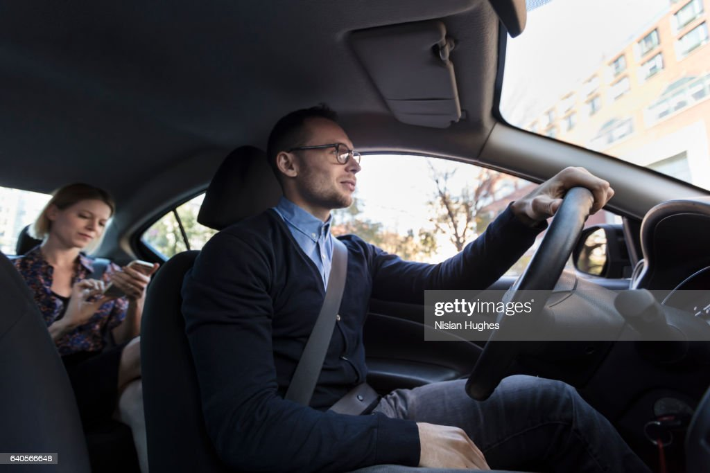Man driving with woman sitting in car : Stock Photo