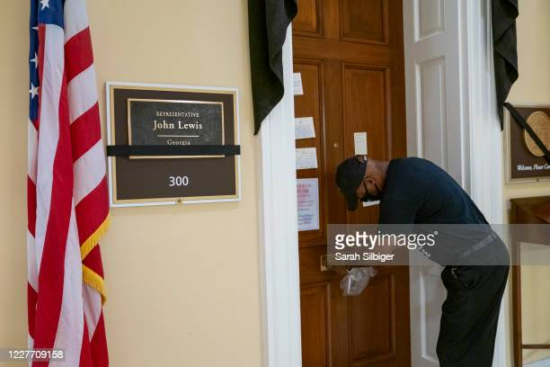 Man drops a letter off at the office of civil rights activist Rep. John Lewis , who died last week, on July 20, 2020 in the Cannon House Office...