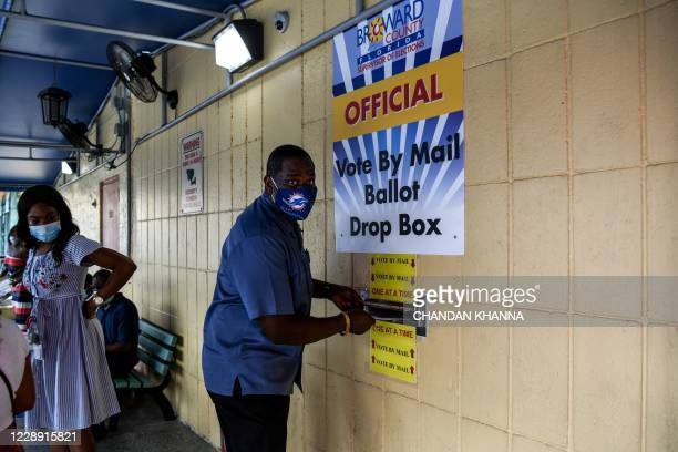 Man drops his ballot by mail at Broward County Supervisor Of Elections Office in Lauderhill, Florida on October 5, 2020.