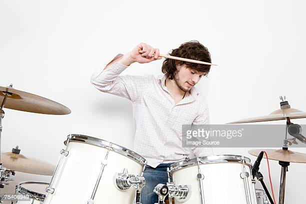 a man drumming - drum kit stock photos and pictures