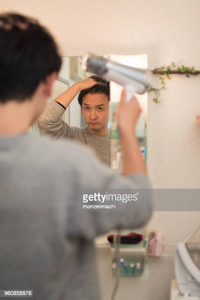 man drying hair - blow drying hair stock pictures, royalty-free photos & images