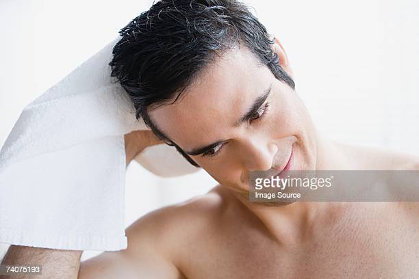 man drying his hair - one man only stock pictures, royalty-free photos & images