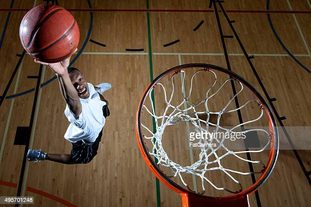 man dunking a baskteball - shooting baskets stock photos and pictures