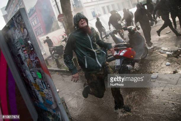 Man during riots in St Pauli district during G 20 summit in Hamburg on July 8 2017 Authorities are braced for largescale and disruptive protests as...