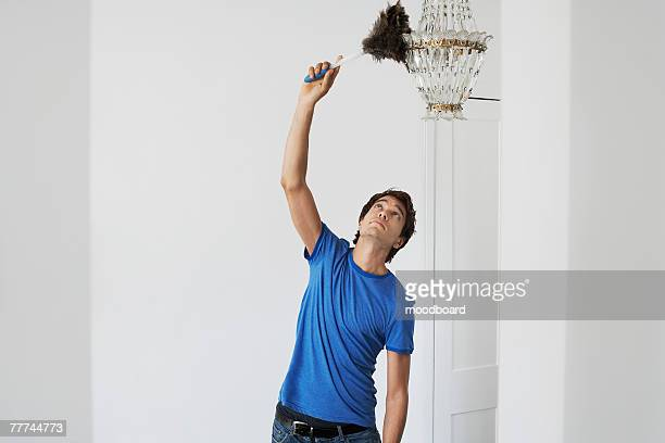 Man Dusting Crystal Chandelier
