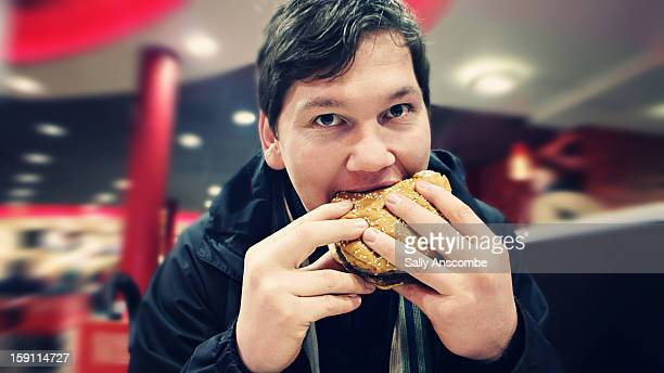 Man eating a hamburger