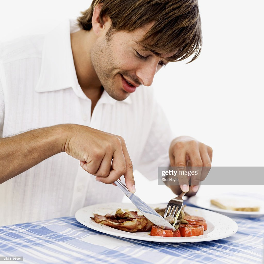 man eating bacon and eggs : Stock Photo