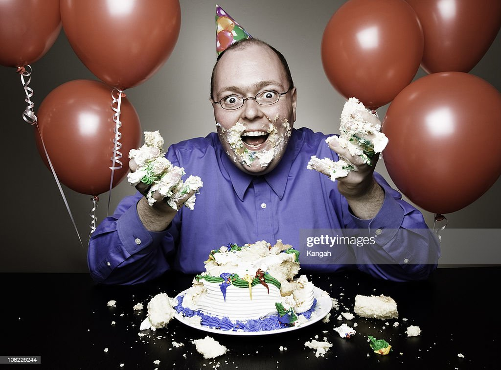 Man Eating Birthday Cake Stock Photo Getty Images
