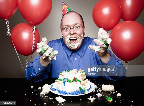 Man Eating Birthday Cake