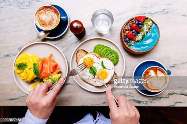 man eating breakfast at the restaurant, personal perspective view - one man only stock pictures, royalty-free photos & images