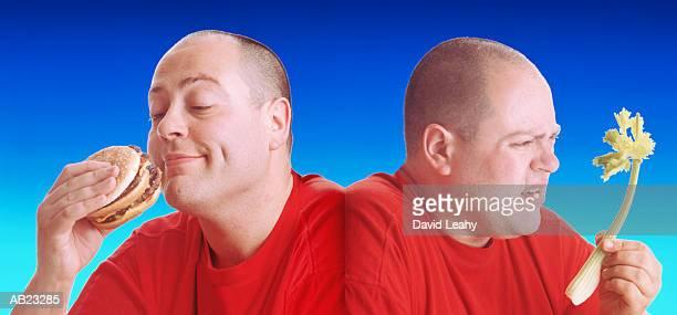 Man eating burger and celery (Digital Composite)