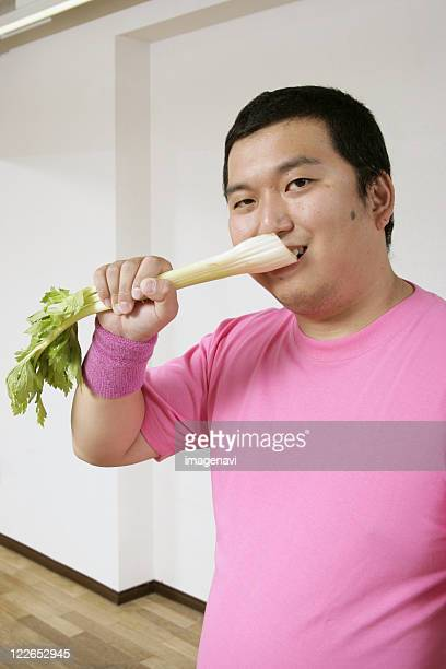 A man eating celery