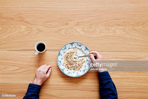 Man eating cereals, directly above