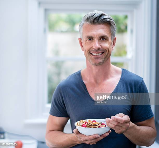 man eating cereals - handsome people stock pictures, royalty-free photos & images