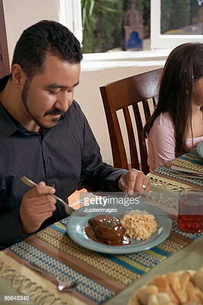 man eating chicken in mole sauce - mole sauce stock pictures, royalty-free photos & images
