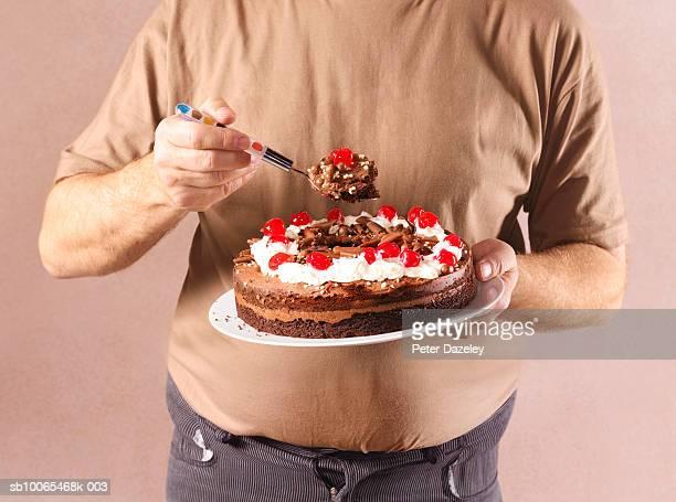 Man eating chocolate cake, close-up