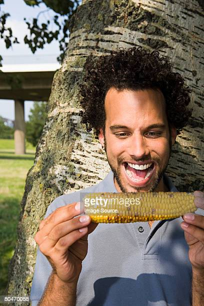 man eating corn on the cobb - corn on the cob stock pictures, royalty-free photos & images