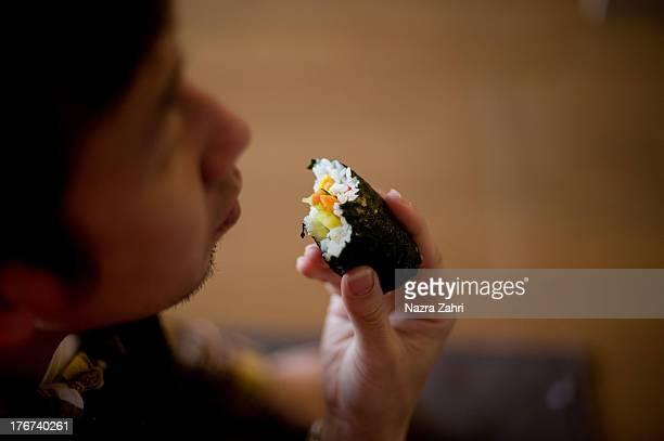 Man eating ehomaki