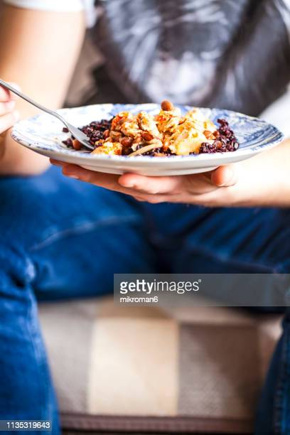 man eating homemade dinner. - pinto bean stock pictures, royalty-free photos & images