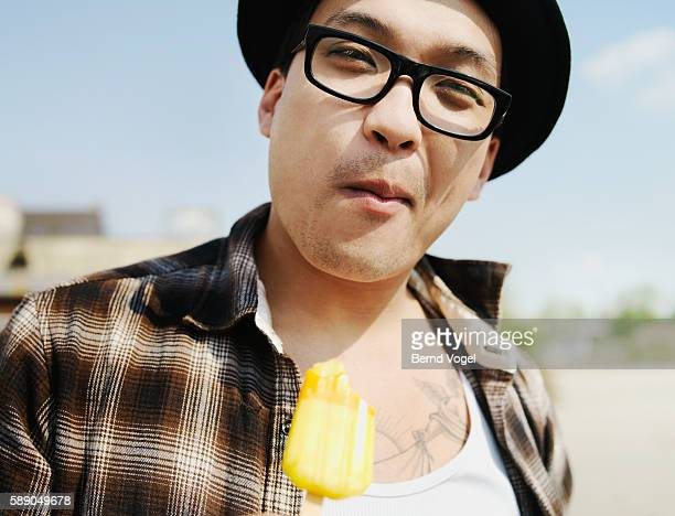 Man eating ice pop