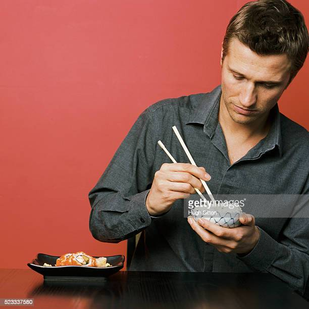 man eating japanese meal - hugh sitton stock pictures, royalty-free photos & images