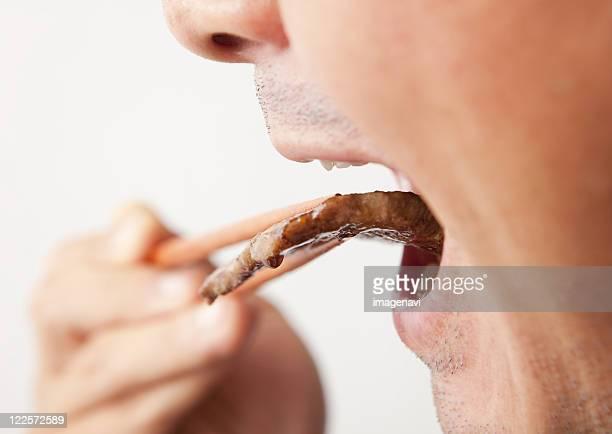 A man eating korean barbecue