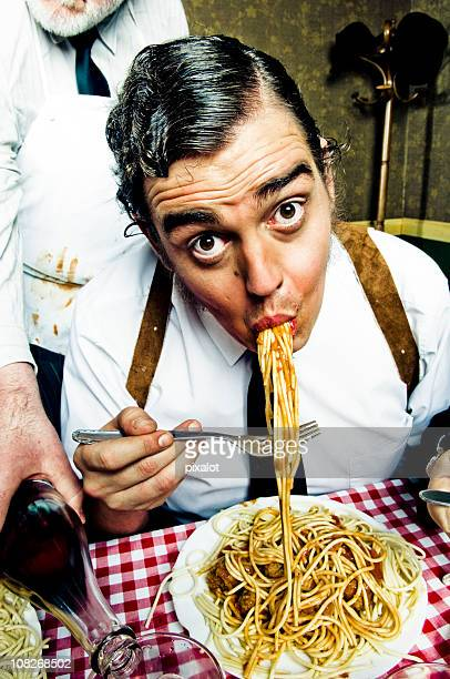 Man Eating Large Plate of Spaghetti