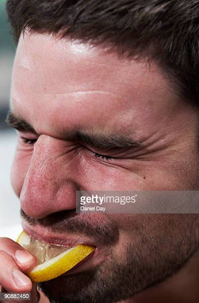 Man eating lemon
