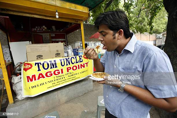 Man eating Maggi at very popular fast food vendor Tom Uncles Maggi Point at Delhi University even after Delhi government banned Maggi from the city...