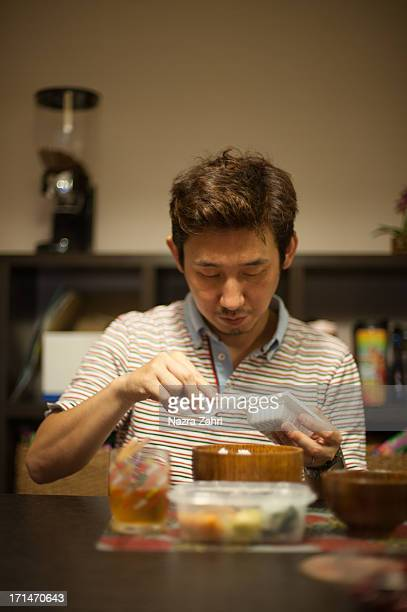 Man eating natto
