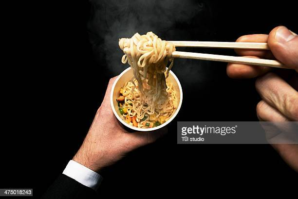 Man Eating Noodles