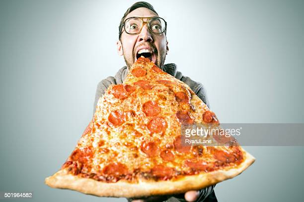man eating oversized pizza slice - pepperoni pizza stock photos and pictures