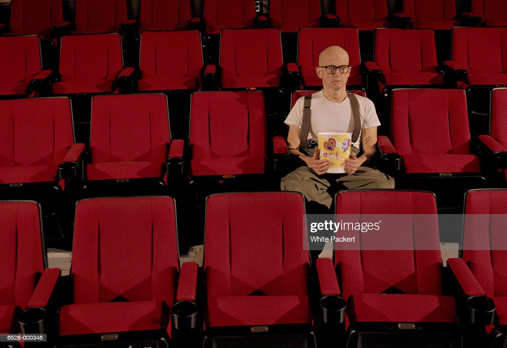 Man Eating Popcorn In Theatre Stock Photo - Getty Images
