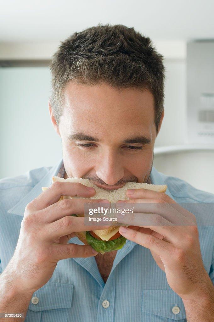 Man eating sandwich : Stock Photo
