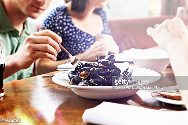 Man eating seafood in restaurant