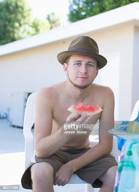 man eating slice of watermelon - jennifer mellone foto e immagini stock