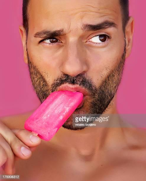 Man eating strawberry ice cream