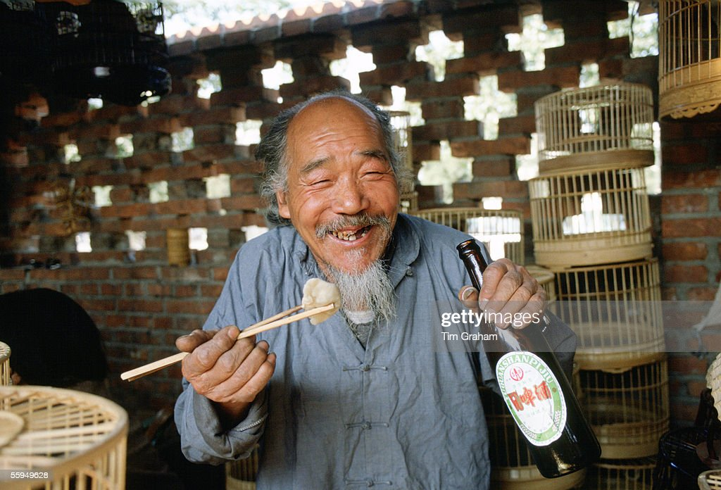 Man Eating and  Drinking, Beijng, China : News Photo